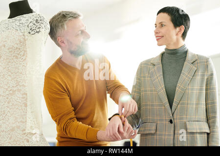 Tailor measuring wrist - Stock Image