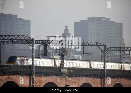 train crossing Stockport landmark Viaduct on route to Manchester - Stock Image