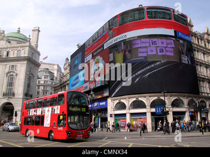Piccadilly Circus and double decker bus London - Stock Image