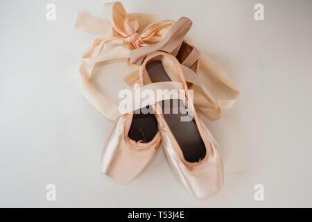 Young ballerina shoes / pointe ballet shoes isolated on white background - Stock Image