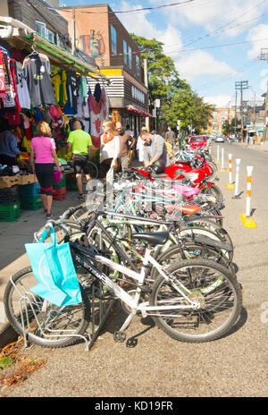 Row of bicycles in Kensington Market in downtown Toronto, Ontario, Canada - Stock Image