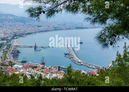 View of the resort town of Alanya, the Lighthouse in the port of Alanya, the old fortress of Alanya, Turkey. - Stock Image