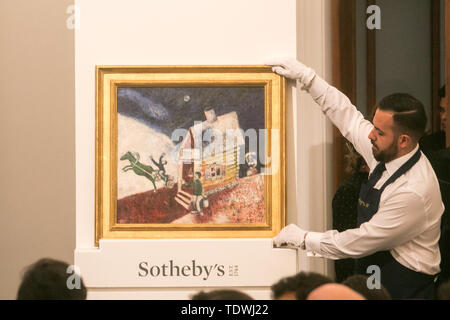 London UK. 19th June 2019. 'La calèche volante' by Marc Chagall, oil on canvas, Estimate £2,000,000m which sold at hammer for £1,900,000m at the Impressionist & Modern Art Evening Auction  at Sotheby's London Credit: amer ghazzal/Alamy Live News - Stock Image