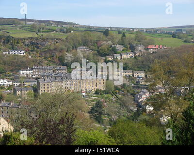 View of the terraces of the town of Hebden Bridge, Calderdale, West Yorkshire, UK and surrounding countryside from high in the surrounding hills - Stock Image