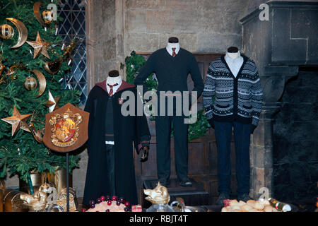 Gryffindor House Uniforms and crest,  on display in the Great Hall, on the Making of Harry Potter Tour,  Warner Brothers Studio's - Stock Image