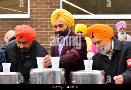 Gravesend, Kent, UK. 13th April. Vaisakhi (or Baisakhi / Vaishakhi / Vasakhi) annual Sikh festival celebrating the Punjabi New Year. Gravesend has a large Sikh community dating back to the 1950s. Free food and drink provided for everyone Credit: PjrFoto/Alamy Live News - Stock Image