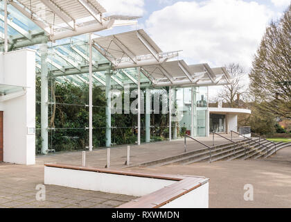 Outside view of the Glasshouse building in Jephson Gardens, showing contemporary steel and glass structure. - Stock Image