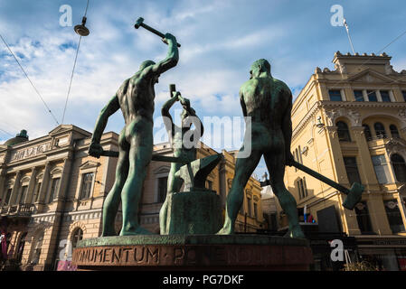 Helsinki statue, the famous statue titled 'The Three Smiths' sited between Aleksanterinkatu and Mannerheimintie in Helsinki city center, Finland. - Stock Image