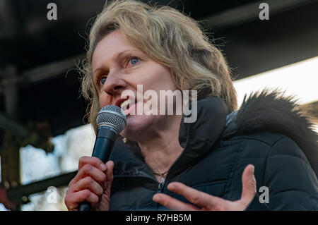 London, UK. 9th Dec, 2018. Author Louise Raw speaks at the rally by united anti-fascists in opposition to Tommy Robinson's fascist pro-Brexit march. The protest by both remain and leave supporting anti-fascists gathered at the BBC and marched to a rally at Downing St. Police had issued conditions on both events designed to keep the two groups well apart. Credit: Peter Marshall/Alamy Live News - Stock Image
