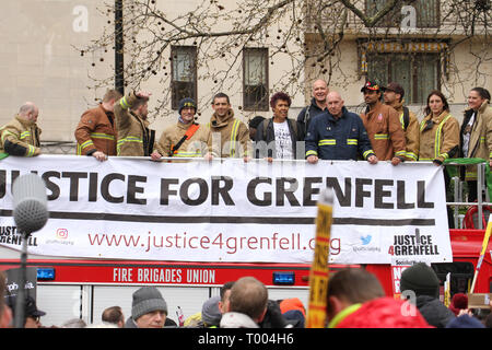 London, UK - 16 March 2019:  Firemen pose for photos  ahead of the march. Thousands of people took part in the UN Anti-Racism Day demonstration that took place in central London on 16 March. The demonstration which began in Park Lank and ended outside Downing Street was organised by Stand Up to Racism and Love Music Hate Racism and supported by the TUC and UNISON. Photo: David Mbiyu - Stock Image