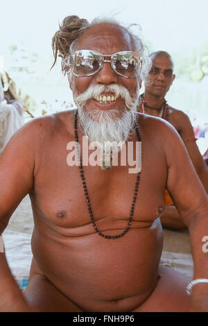 Naga Sadhu from the Juna Akhara posing in a pair of sunglasses at his ashram, Simhastha Kumbh Mela 2004, Ujjain, - Stock Image