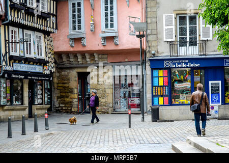 Sunday stollers on a casual walk through the historic heart of Quimper, Brittany, France. - Stock Image