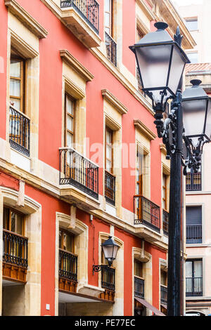 Lampost and colourful building with balconies, Gijon, SPain - Stock Image