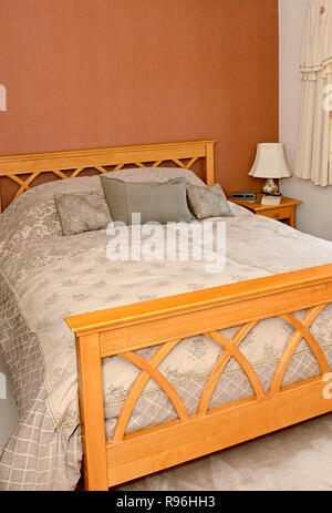 Modern oak bed - Stock Image