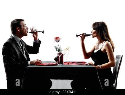 couples lovers dinning drinking wine in silhouettes on white background - Stock Image