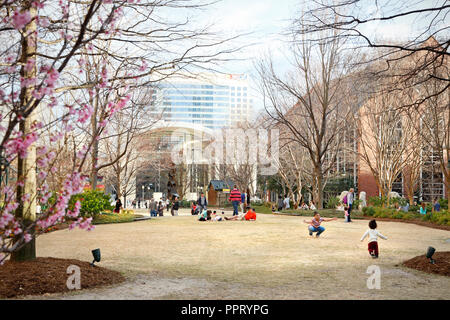 Charlotte North Carolina. People hanging out in The Green city park in Uptown. - Stock Image