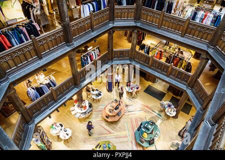 London England United Kingdom Great Britain Soho Liberty Department Store shopping luxury brands upmarket atrium lightwell Tudor revival architecture - Stock Image