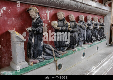 16th century stone carved and painted sculptures on a tomb inside St Andrew the Apostle Church in Hurstbourne Priors, Hampshire, England, UK - Stock Image