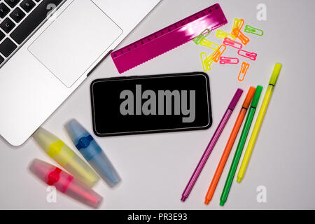 School concept. Smartphone with text space, copy space on desktop. - Stock Image