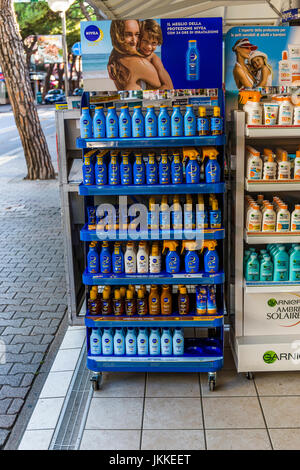 Shop shelf with nivea sun creams next to a stone pavement. - Stock Image