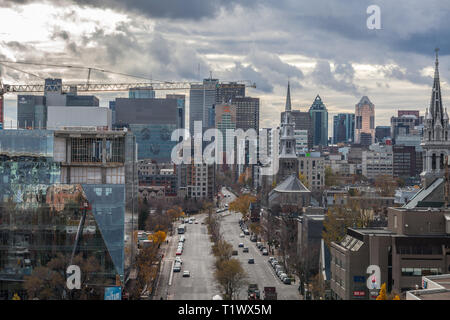 MONTREAL, CANADA - NOVEMBER 8, 2018: Skyline of Montreal CBD seen from Le Village district on the Rene Levesque Boulevard street during a cloudy after - Stock Image