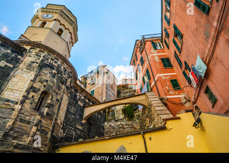 The Santa Margherita di Antiochia Church with it's bell tower and clock at the hillside village of Vernazza, - Stock Image
