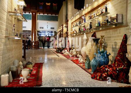 Baghdad, Iraq. 23rd Apr, 2019. People walk in a corridor at the Festival of the Institute of Crafts and Folk Arts in Baghdad, Iraq, April 23, 2019. Credit: Khalil Dawood/Xinhua/Alamy Live News - Stock Image