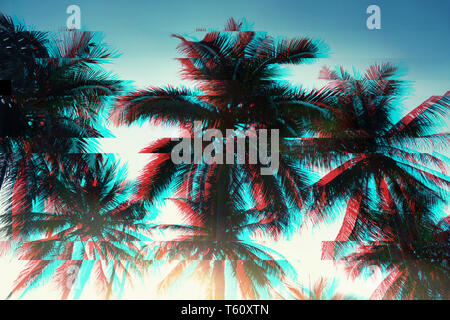 Background of the branches of tropical palm trees, the sky in vintage style. Toning. glitch effect. - Stock Image