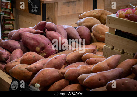 Sweet Potatoes & Yams For Sale In Produce Aisle in Grocery Store, USA - Stock Image