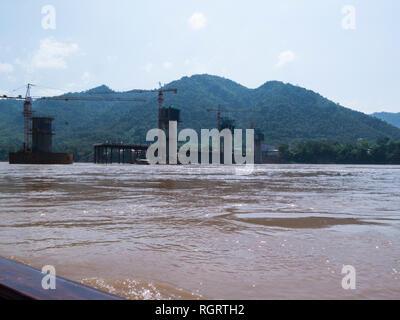 New China Bridge under contruction over mighty Mekong River Prabang Luang Laos constructed by China Railway No.8 Engineering Group Co Ltd linking Laos - Stock Image