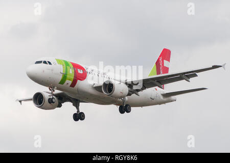 London, Uk - August 6, 2013 - A TAP Portugal airliner lands at Heathrow Airport in London - Stock Image