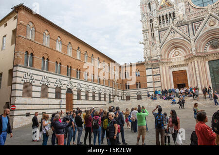 Siena cathedral duomo and tourists sightseeing,Siena,Tuscany,Italy - Stock Image