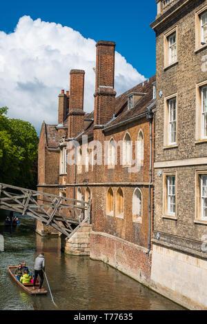 Punters go under the Mathematical bridge at Queens College Cambridge. UK - Stock Image