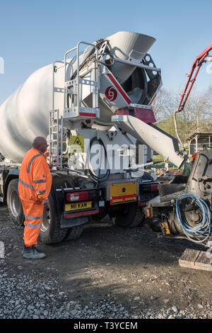 Presteigne, Powys, Wales, UK. A truck delivering ready mix concrete, to be pumped into the foundations of a new building - Stock Image