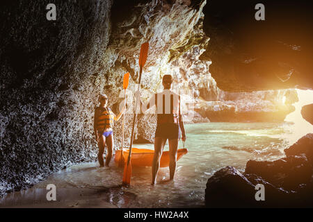 Couple of kayakers in sea cave - Stock Image