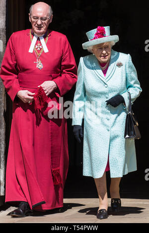 Windsor, UK. 21st April 2019. The Queen leaves St George's Chapel in Windsor Castle with the Dean of Windsor, the Rt Revd David Conner KCVO, after attending the Easter Sunday service. Credit: Mark Kerrison/Alamy Live News - Stock Image