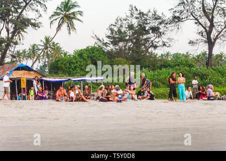 GOA, INDIA - NOVEMBER 17, 2011: Hippies at Arambol beach in north Goa in India at sunset - Stock Image