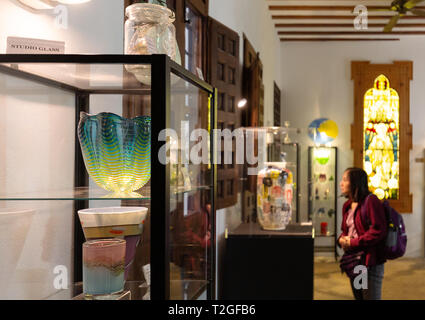 A tourist visitor in the Malaga Museum of Glass and crystal, interior, Malaga Spain Europe - Stock Image