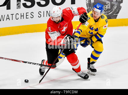 Bratislava, Slovakia. 18th May, 2019. From right hockey player of Sweden WILLIAM NYLANDER and VINCENT PRAPLAN of Switzerland in action during the match Sweden against Switzerland within the 2019 IIHF World Championship in Bratislava, Slovakia, on May 18, 2019. Credit: Vit Simanek/CTK Photo/Alamy Live News - Stock Image