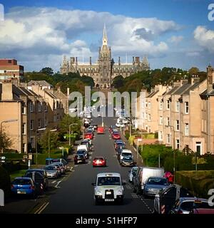 Private school in Edinburgh neighbourhood on a sunny day with taxi cab - Stock Image