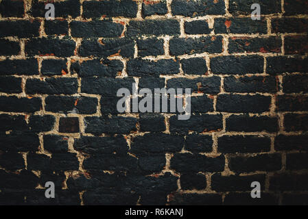 Wall from old burned brick.Texture background; Old aged brick wall - Stock Image