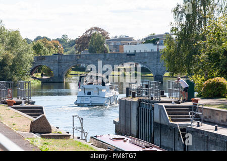 Cruise boat leaving Chertsey Lock, Chertsey, Surrey, England, United Kingdom - Stock Image