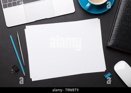 Office workplace table with blank paper page, coffee cup, supplies and computer. Flat lay. Top view with space for your goals - Stock Image
