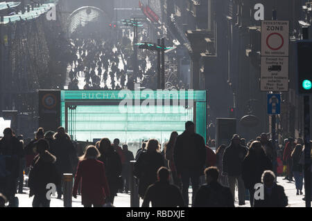 Buchanan Street, Glasgow, Scotland backlit by winter sun - Stock Image