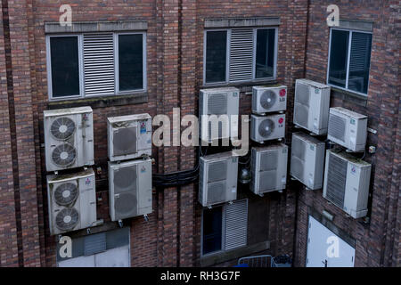 A collection of air conditioning units on the outside of an office building in Chester city centre UK - Stock Image