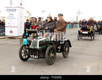 Lydia Farley driving a 1902, Peugeot, over the finish line, of the 2018 London to Brighton Veteran Car Run - Stock Image