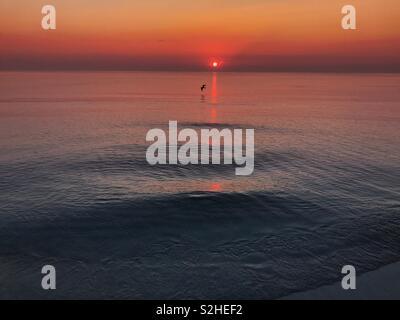 Sunrise over sea - Stock Image