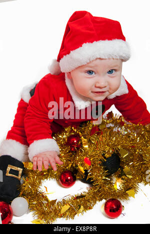 Cute baby in father Christmas outfit - Stock Image