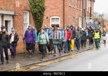 A large group of ramblers with outdoor gear in the rain on the Joseph Arch Centenary Walk. - Stock Image