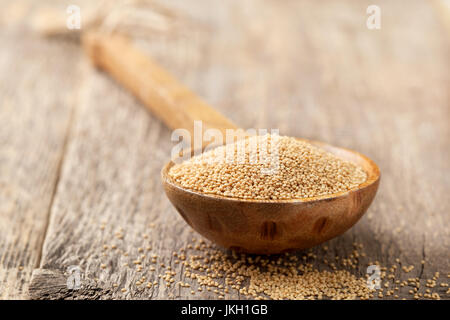 amaranth in a wooden spoon on the old wooden background closeup - Stock Image